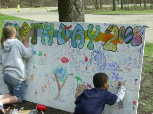 Kids decorate a banner at last year's festival