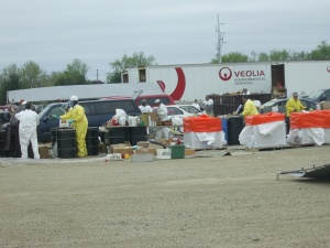Hazardous Waste works empty the cars of residents who attended the event at Expo Gardens in 2008.