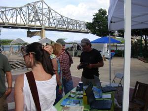 Concertgoers chat with local vendors at the 2008 Universal Rhythm Assembly in Peoria, IL.
